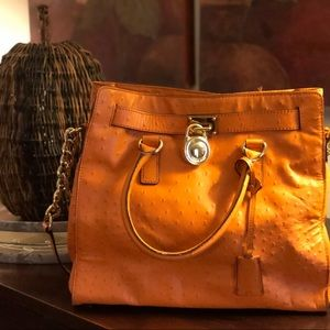 Textured orange Michael Kors purse.